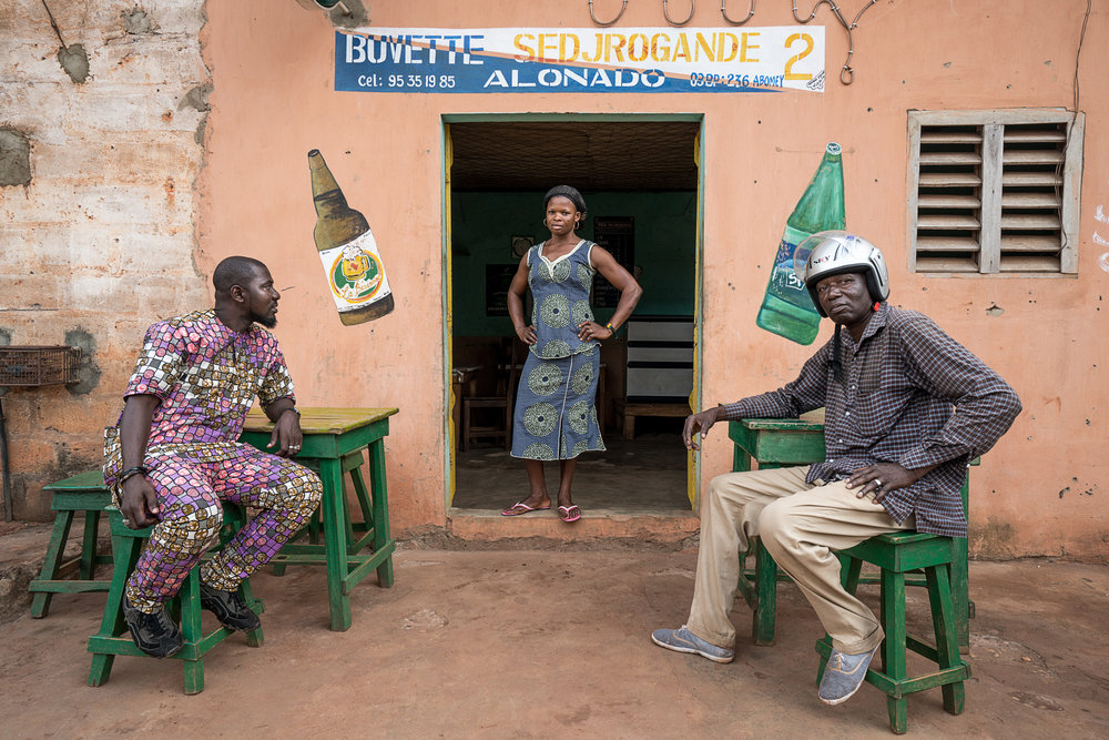 Benin_2000_Two men with woman in a bar.jpg