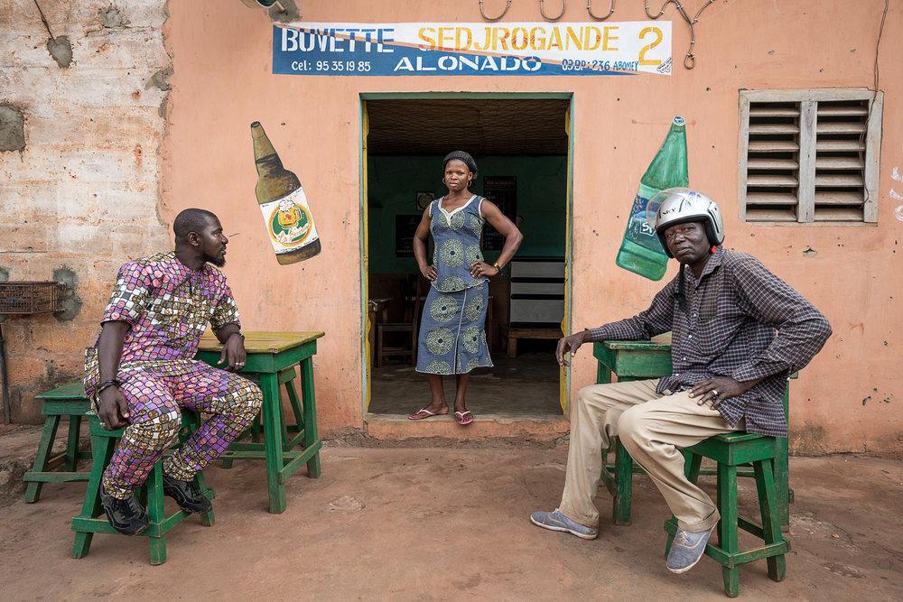 Benin_2000_Two men with woman in a bar.jpg