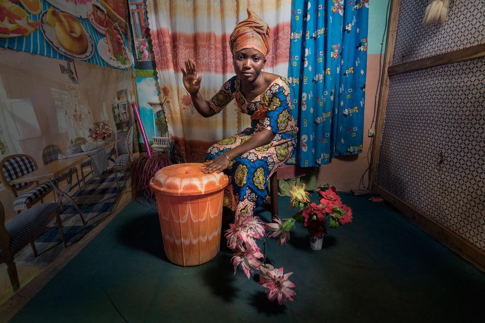 Woman with garbage drum.jpg