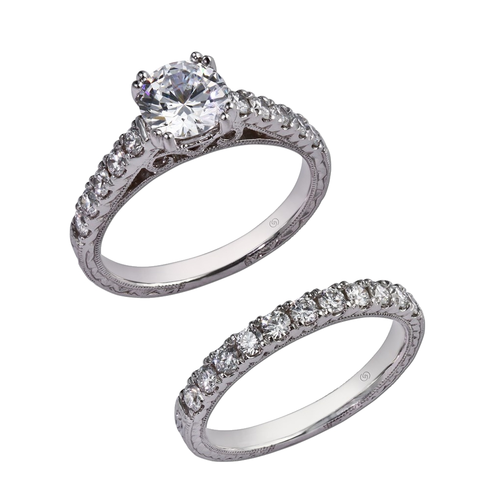 Classic setting with delicate hand engraving.  Prong set diamonds climb up the cathedral shoulders, showcasing a gorgeous center stone, set in a split prong head, and delicate beadwork running along the entire ring.  With wedding band for bridal set. Style 28431