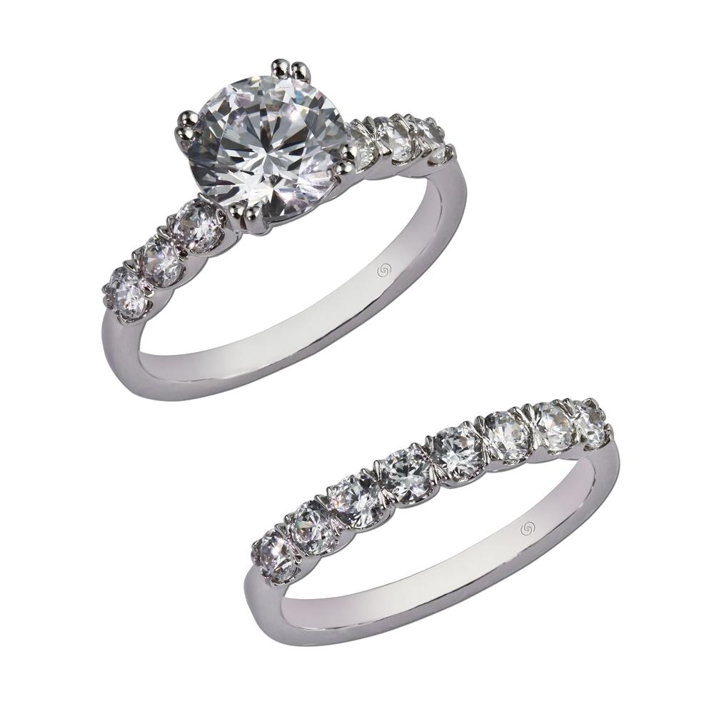Engagement ring with half bezel set diamonds leading up to a larger center stone.  With wedding band for bridal set. Style 28913
