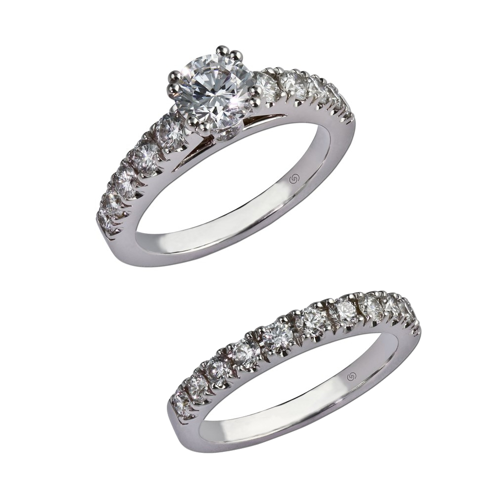 Engagement ring with individual prong set diamonds, cathedral shoulders, and a stunning center stone. A peek-a-boo diamond is bezel set in either side of the gallery.  With wedding band for bridal set. Style 28132