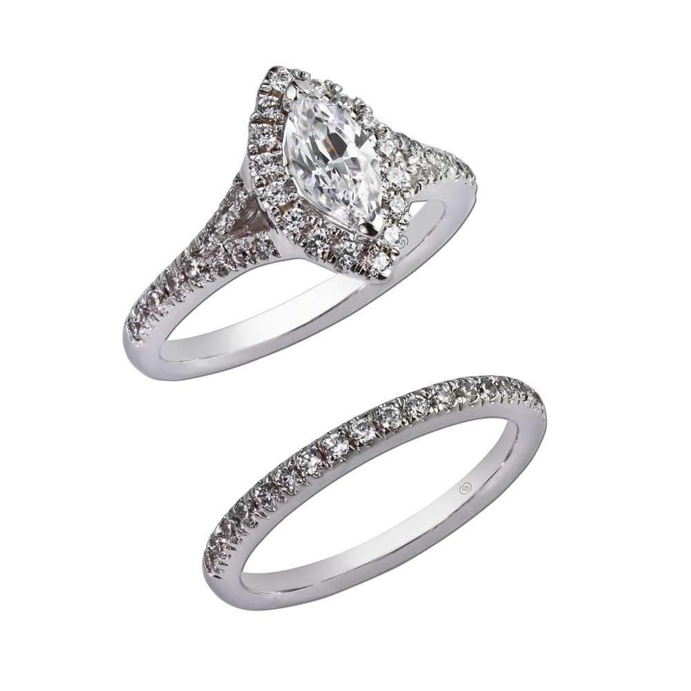 Marquise shaped, diamond micro-pavé halo top, joined by a short split shank exhibiting sparkling micro-pavé diamonds down the finger.  With wedding band for bridal set. Style 28940