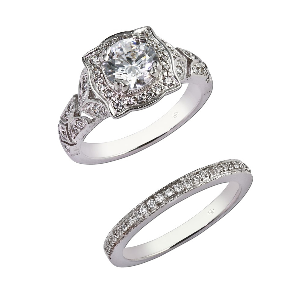 Intricately designed engagement ring with an eye-catching halo setting surrounded by sparkling bead set diamonds, and bordered by a detailed milgrain edge.  With wedding band for bridal set. Style 28704