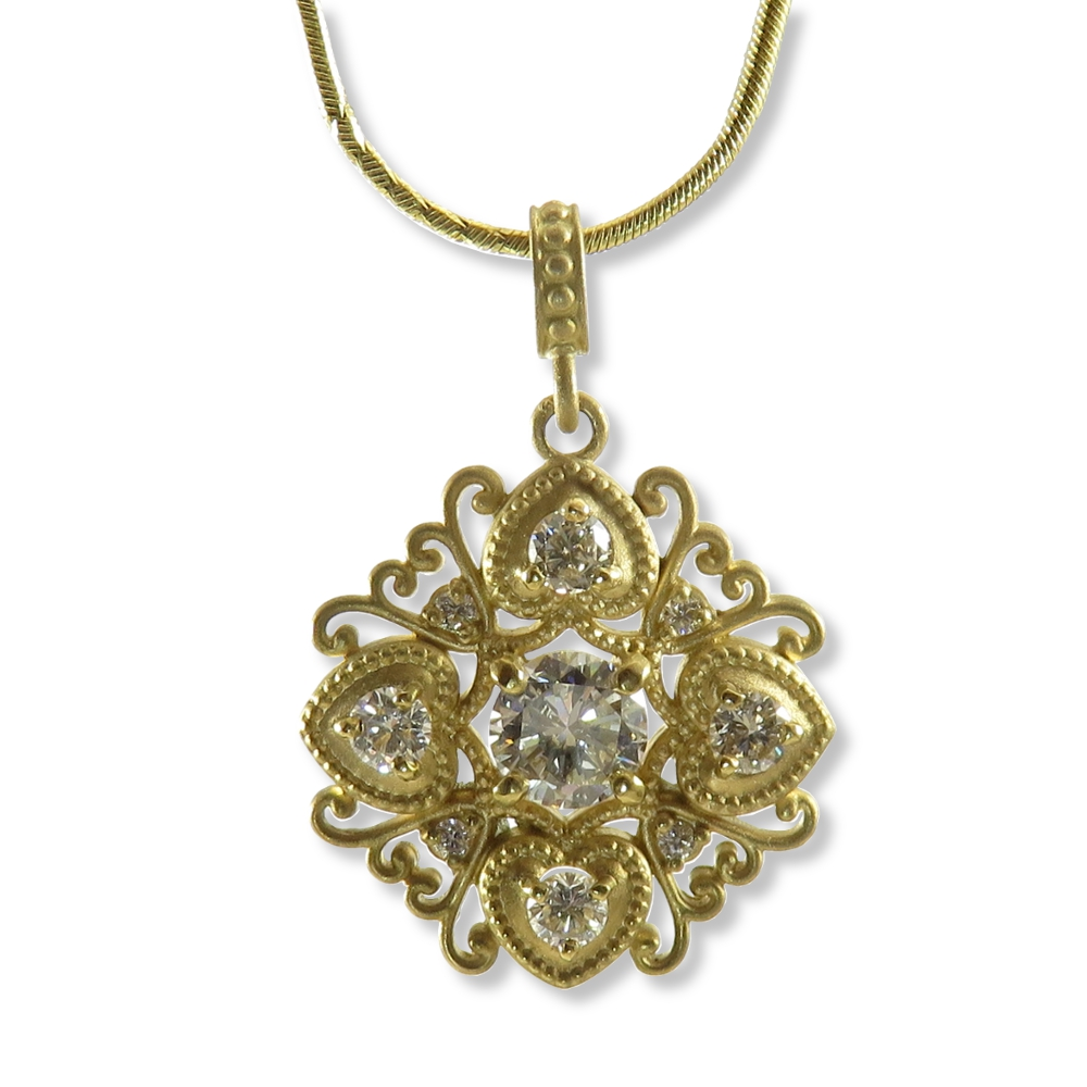 Vintage style brushed yellow gold and diamond pendant.