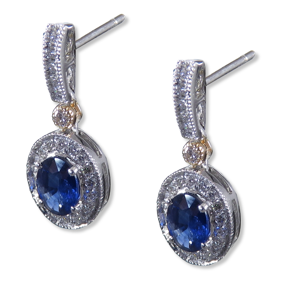 Sapphire and diamond earrings in two-tone gold and milgrain. Wilkersons