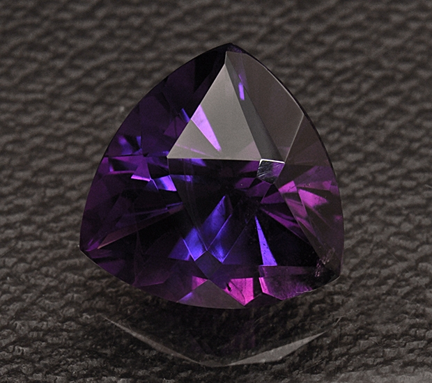 Amethyst, once though to protect the wearing from getting drunk.