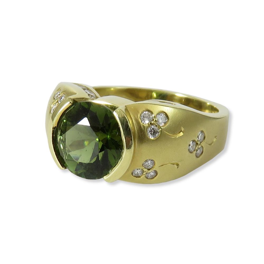 18K yellow gold and green tourmaline ring with diamonds set to look like shamrocks. Estate