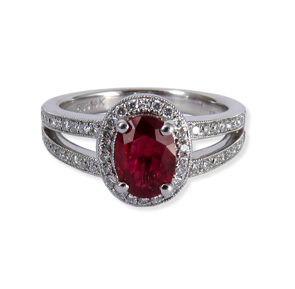 Ruby and diamond ring in white gold with a split shank. DiaExpressions
