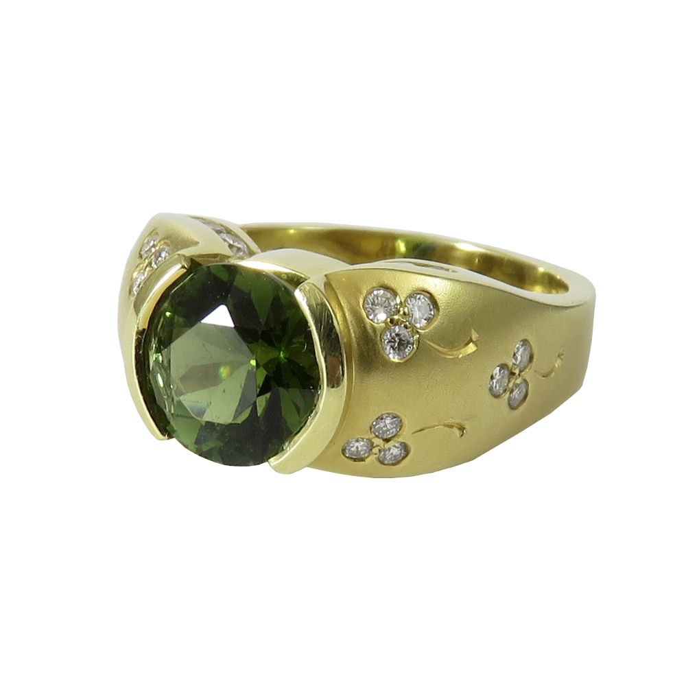 18K yellow gold and green tourmaline ring with diamonds set to look like shamrocks. Estate