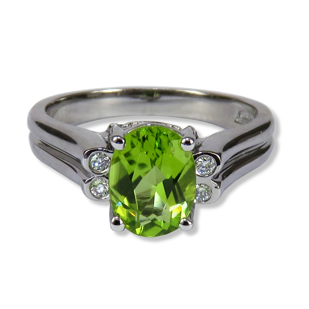 Peridot ring in white gold with diamonds. Engel Brothers 1386P
