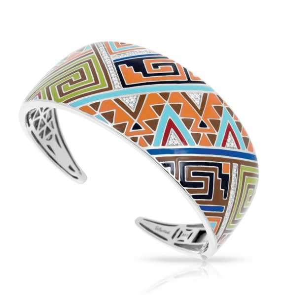 Like the marvelous natural rock formations found in the southwest, Sedona expresses an intricate triangular mosaic of sharp shapes and lines. Luminous stones peek through the rich vibrant color palette of hand-painted Italian enamels.