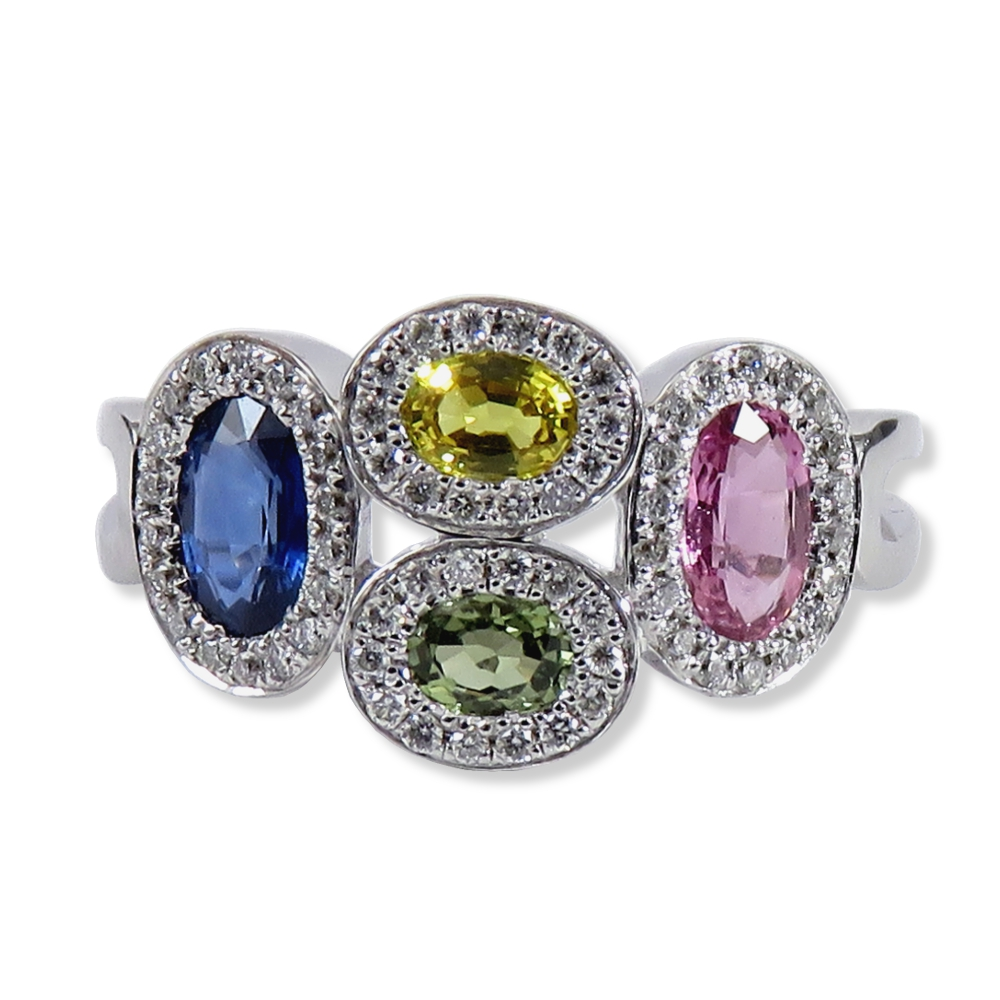 Fun blue, yellow, green, and pink sapphire ring with diamonds in white gold. Allison Kaufman