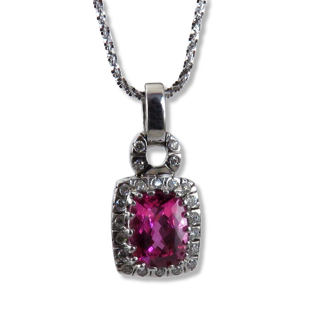 Stunning pink tourmaline is a 14k white gold, handmade pendant mounting with diamonds. William August