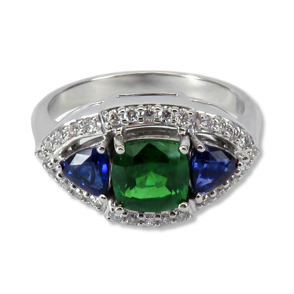 Tsavorite garnet and sapphire ring in white gold with diamonds. William August