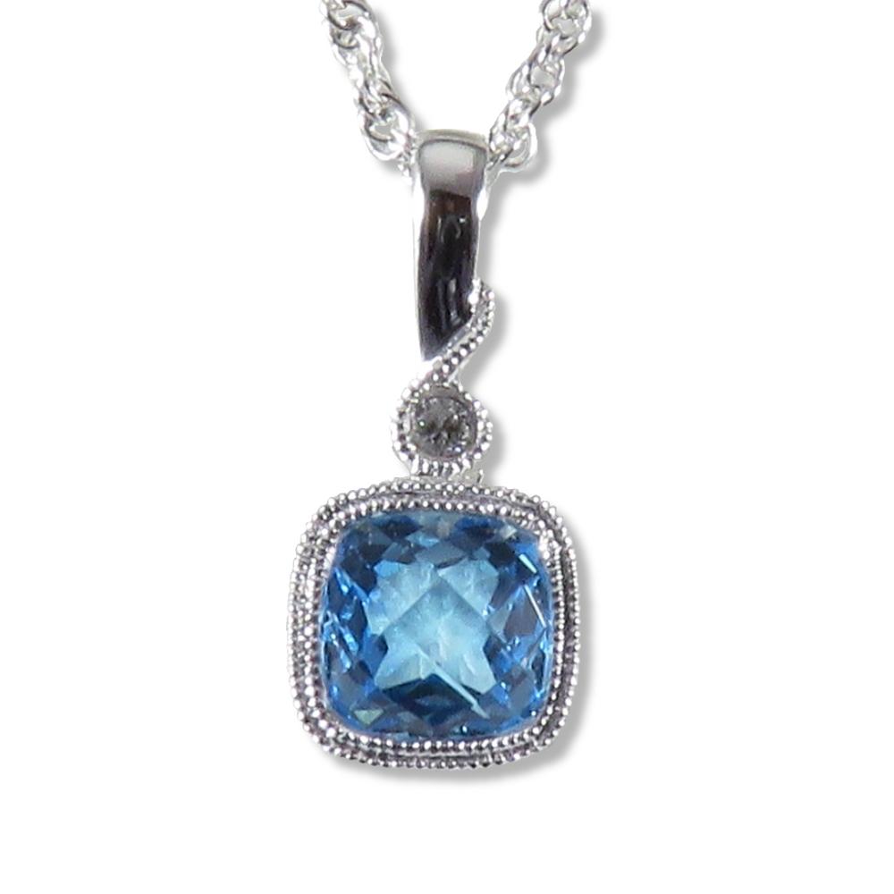 Blue topaz pendant with milgrain in 14k white gold. Allison Kaufman