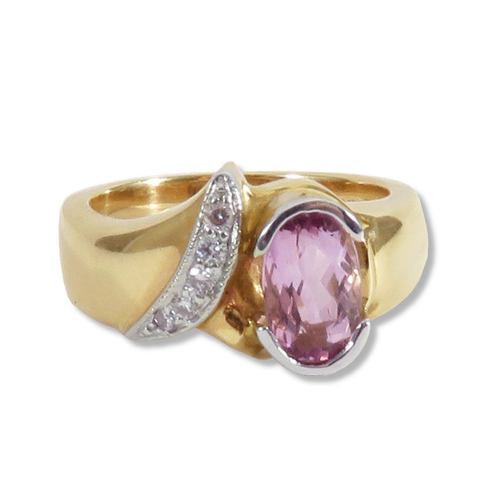 Pink topaz with diamonds in 14k yellow and white gold.