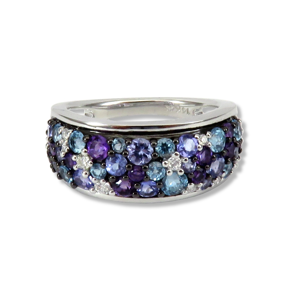 Blue topaz, tanzanite, amethyst, and diamond ring in 14k white gold. Allison Kaufman