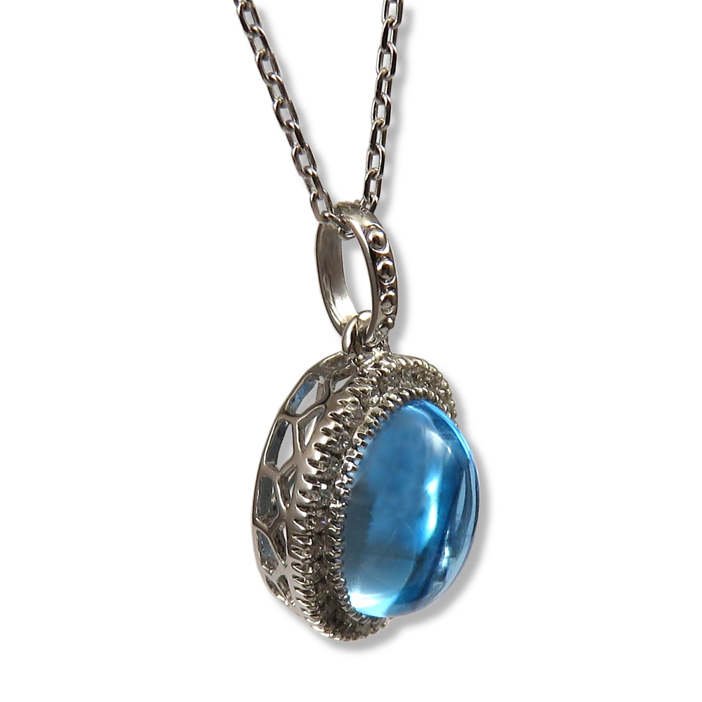 Blue topaz cabochon pendant in 14k white gold.
