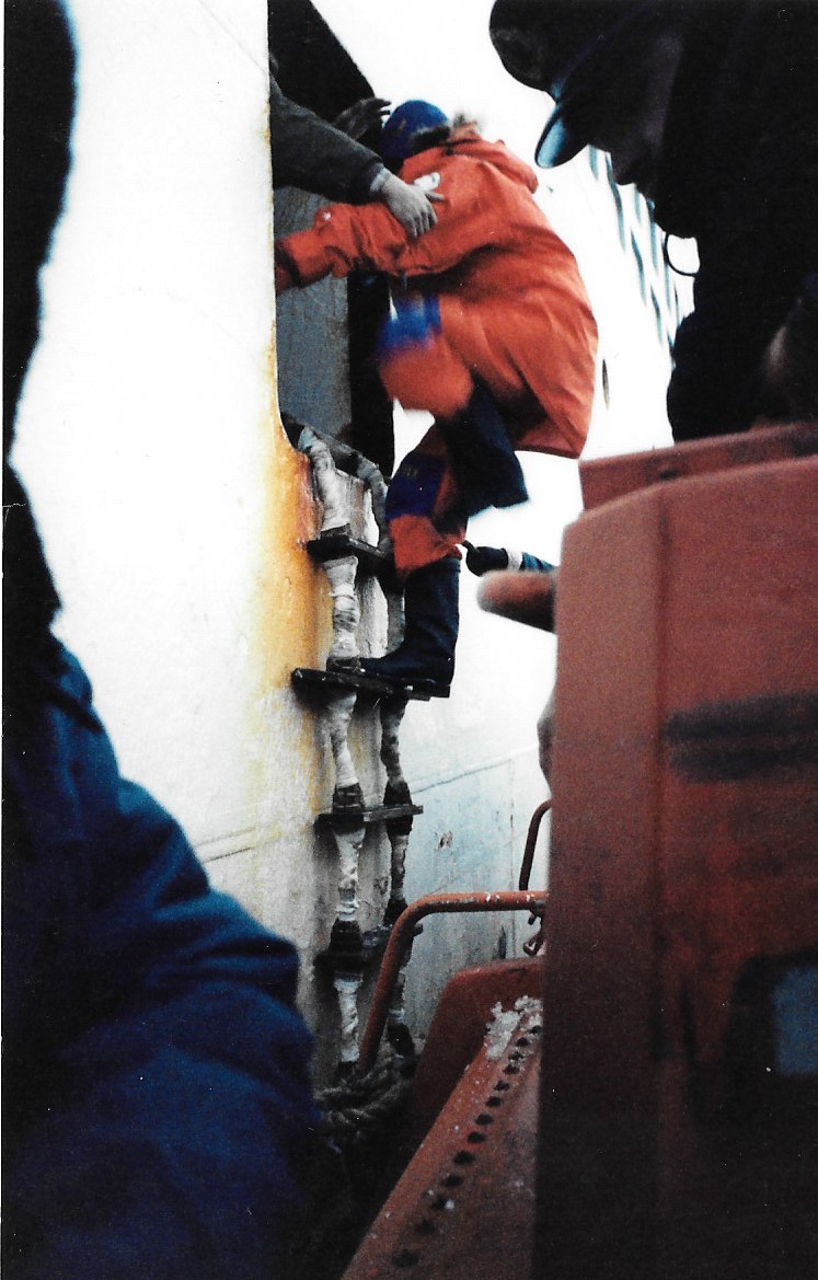 Jean-Louis Etienne jumps from the small boat onto the  Professor Zubov  as the Trans-Antarctica expedition leaves the continent. Photo: Jacqui Banaszynski