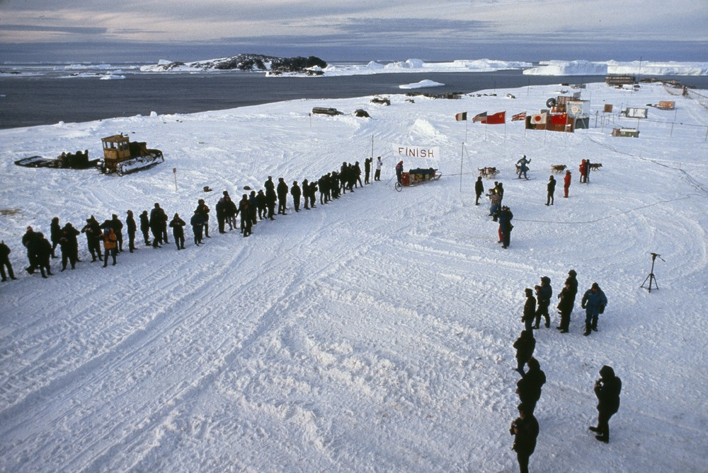 After 3,741 miles from ocean to ocean, The 1989-1990 International Trans-Antarctica Expedition crosses the finish line at the Soviet Union's Mirnyy base on the Indian Ocean. March 3, 1990. ©Trans-Antarctica, Photo by Per Breiehagen