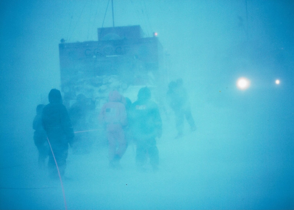 Upon realizing that Keizo has disappeared, the Trans-Antarctic team and Soviet trax drivers prepare the search. Photo: Laurent Chevalier