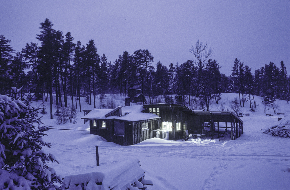 Main lodge and scattered cabins, Will Steger's Homestead in 1987. ©Trans-Antarctica photo by Per Breiehagen