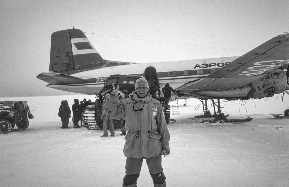 Trans-Antarctica photographer Per Breiehagen celebrates after the Soviet transport plane he was riding in was pulled from the snowbank in which it landed. ©Trans-Antarctica photo by Per Breiehagen.
