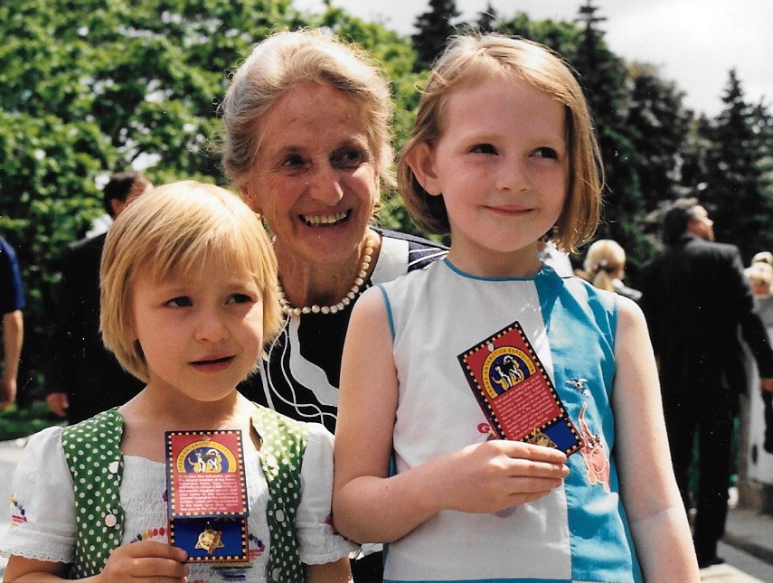 Two Russian children pose with W. L. Gore matriarch Vieve Gore as they receive Trans-Antarctica pins produced and donated by Target Stores. Moscow, June 1990. Photo: Jack Dougherty