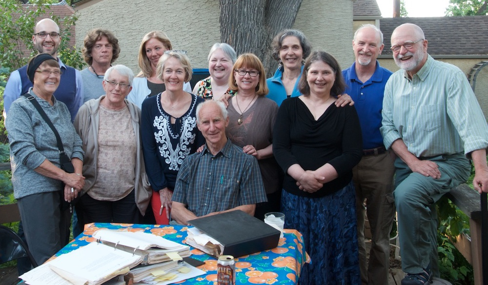 Some of the 1990 Trans-Antarctica Expedition staff gathered to visit British team member Geoff Somers (seated) when he came to town June 6, 2015. Front left: Pat Braski, Deb Gandhorn, Jennifer Gasperini, Paula Berglund-Swanson, Cathy de Moll, Steve Buetow. Back left: Hans Buetow, Dave Sheild, JuliePeters-Wright, Deanna Peterson-Mello, Cynthia Mueller, Jim Gasperini