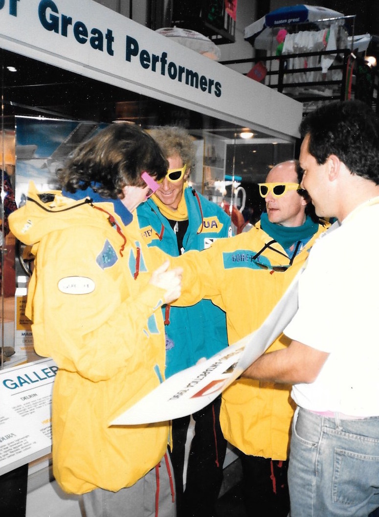At the 1989 U.S. National Ski Show, team members Will Steger, Jean-Louis Etienne and Geoff Somers wear their prototype jackets and try on sunglasses as they wait for their appearance at the Gore-Tex party. Photographer unknown