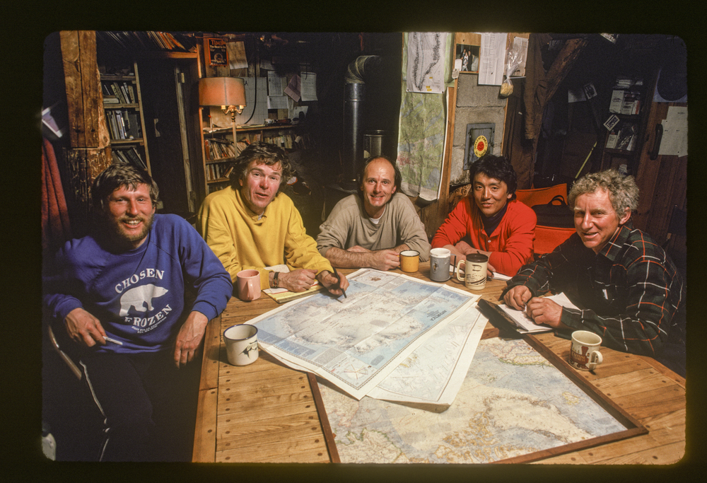 Early meeting at the Homestead, five of the six team members study the maps of Antarctica and Greenland. Photo ©Trans-Antarctica, by Per Breiehagen