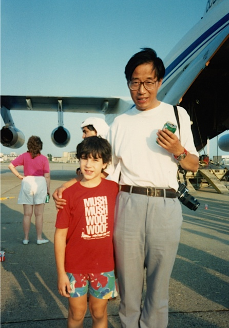 Son Hans Buetow and Chinese team member, Qin Dahe pose in front of the Illyushin 76 in Minneapolis, July 16, 1989. Photographer unknown