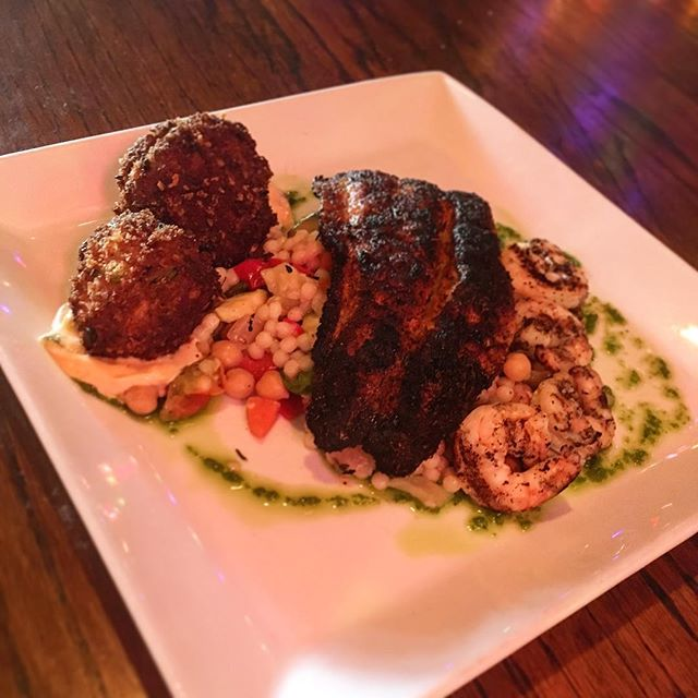 CATCH OF THE DAY 🎣 Blackened red fish with crab fritters, grilled shrimp, vegetable cous cous and remoulade sauce #catchoftheday #fish #redfish #crabfritters #fireflygrillenashville #nashvillerestaurants #nashville #greenhills #bandywood #locallyowned