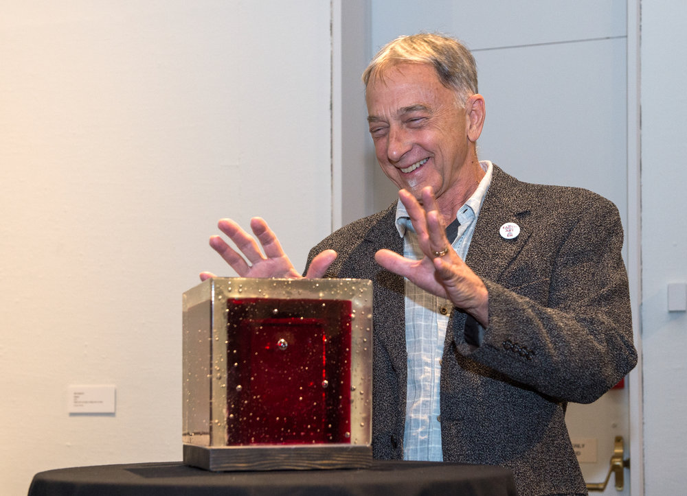 Chris Bruce, Director, Museum of Art/WSU receives a farewell thank-you gift from Olson Kundig and museum staff