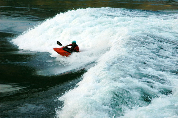 Watch thrill seekers surf the Skookumchuck Rapids