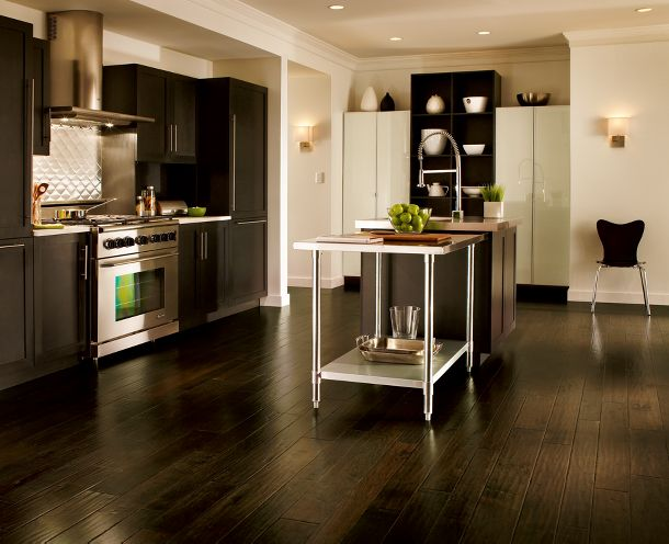 Dark hardwood works here because it contrasts with the white walls and cabinetry, from Armstrong Flooring