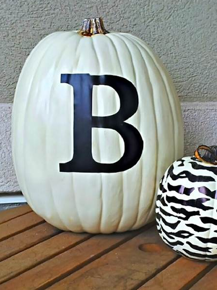 Want this look? Spray paint a large pumpkin with white paint and simply peel and stick on a monogrammed letter.  Today.com