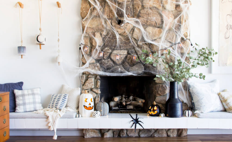 Subtle Halloween....I simply LOVE  Emily Henderson's  use of black and white and how the decor easily fits into her everyday design.