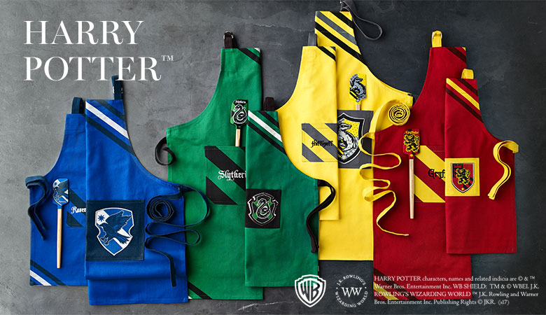 Aprons ($24.95 & $39.95) and Spatulas ($12.95) now at Williams Sonoma available in kids and adult sizes   .