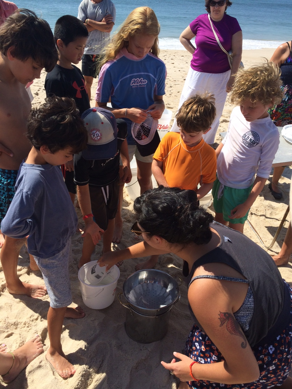 Shelly showing the kid's how to strain salt water properly.  Photo: Molly Adams, SoFo.org
