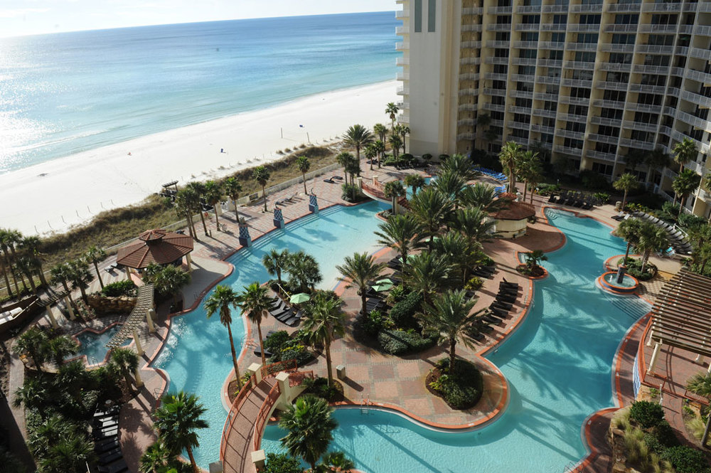 Our amazing pooldeck.  The largest in PCB!  Soak in a view like no other, enjoy live entertainment, poolside dining, and a full bar!