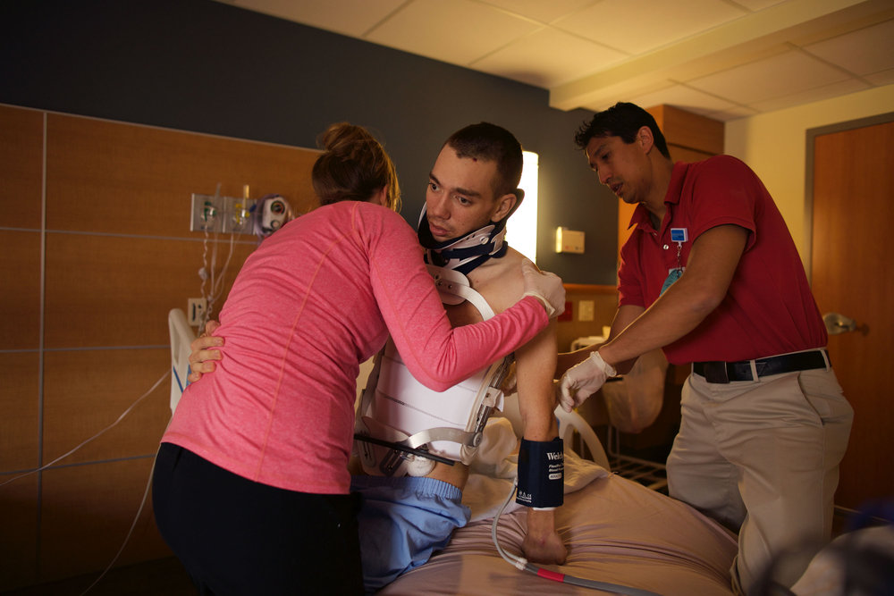 Doctors at Golisano Rehab Center help Chris get into bed on March 3rd, 2016.