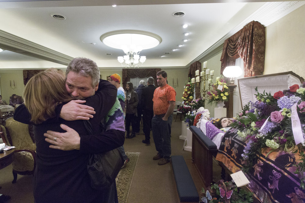 Family and friends mourn the loss of Paul Doughty at the R.H. Schlep & Son Minoa Chapel in Minoa, N.Y. on Nov. 17, 2015.  Paul, 28, passed away Nov. 12, 2015 from a Heroin overdose.