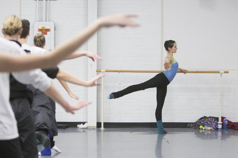 Jessica Tretter, 29, pursues bar exercises as a part of her daily routine on Nov. 18, 2014 at Draper Academy of Dance in Rochester, N.Y. Tretter rehearses six to eight hours a day, six days a week.