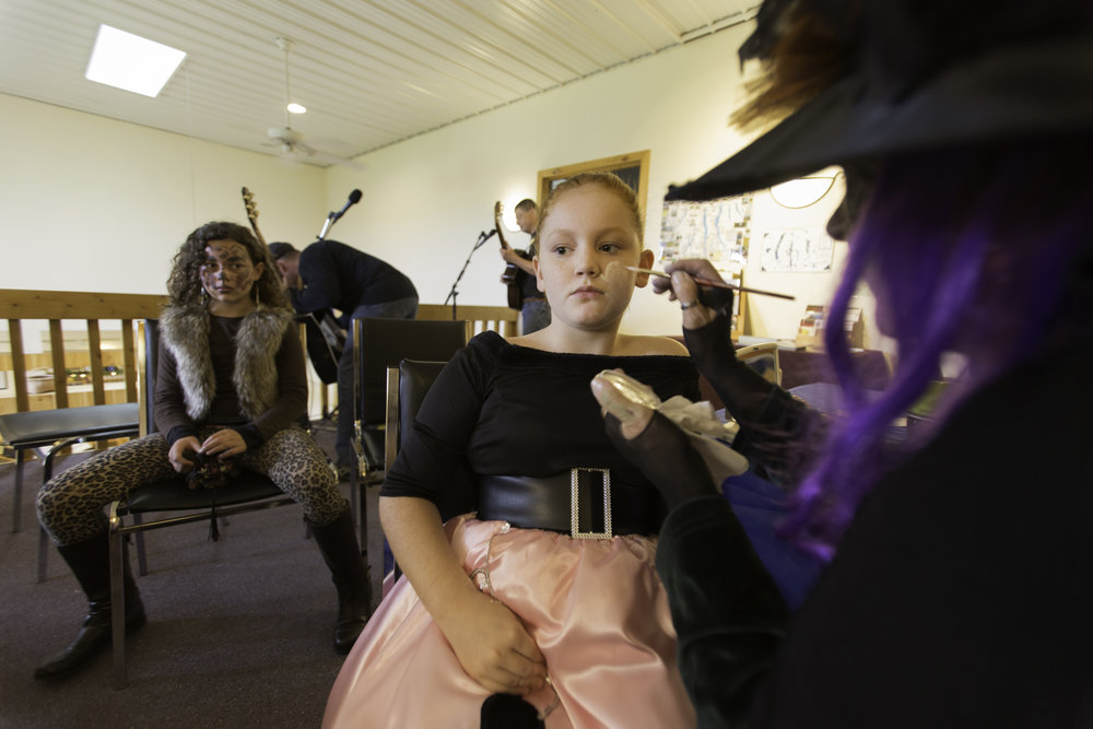 Kids line up to get their faces painted at the halloween festival hosted by the Geneseo Valley Vineyard in Geneseo, N.Y. Oct. 5, 2014.