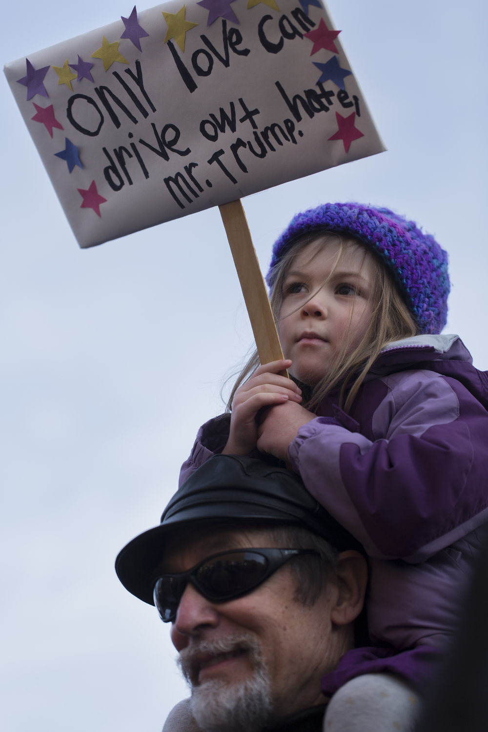 "Charlotte Corey, 3, sits on her grandfather, Bob Gillespie's shoulders at the Women March held at the Women's Rights National Historical Park in Seneca Falls, N.Y on Jan. 21, 2017. ""I'm terrified to see my precious girl growing up in a country led by a sexual predator,"" said Gillespie. ""I'm scared about the kind of behaviors his leadership will allow to take place. But today, we all stand in solidarity. Today, we're showing Charlotte the good."""