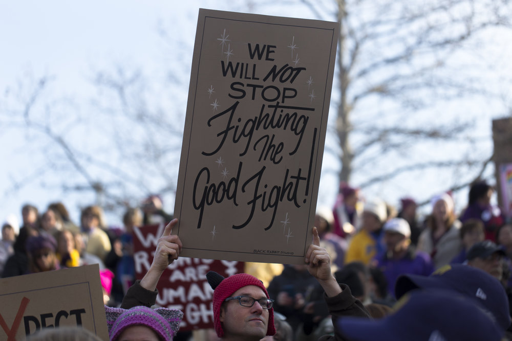 "Lou Boudreau, from Syracuse, holds up his sign at the Women March held at the Women's Rights National Historical Park in Seneca Falls, N.Y on Jan. 21, 2017. ""I just can't bear to see America go back in time,"" said Boudreau. ""I promise to never stop fighting the good fight."""