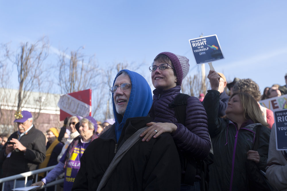 A couple listens to a song being performed at the Women March held at the Women's Rights National Historical Park in Seneca Falls, N.Y on Jan. 21, 2017. Over 2,000 protesters gathered at the march.