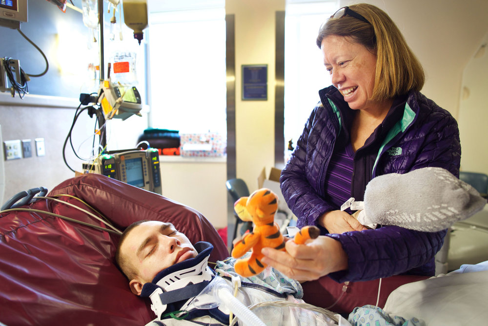 Sarah Clemens tells her son Chris, 21, about the stuffed Tigger a family friend sent him in effort to get him to respond at Strong Memorial Hospital on February 29th, 2016. Chris was hit by two cars on February 13th and suffered from a Diffuse Axonal Injury, a type of Traumatic Brain Injury.